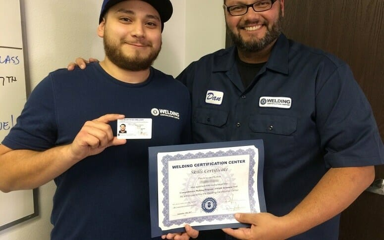 Two Guys Holding Welding Certificate