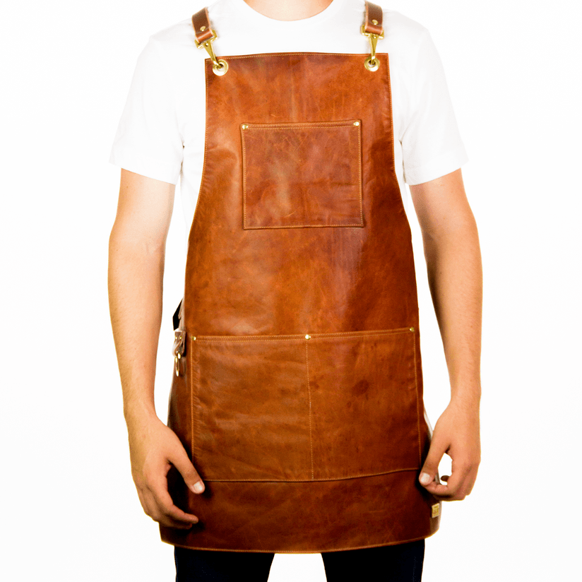 wearing welding apron