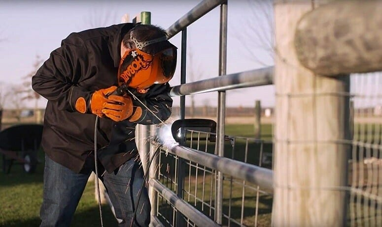 Man Welding Fence