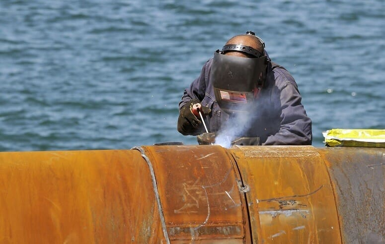 Welding Two Pipes In Harbour