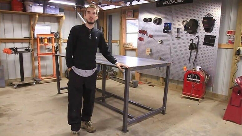 Man Standing Next To DIY Welding Table