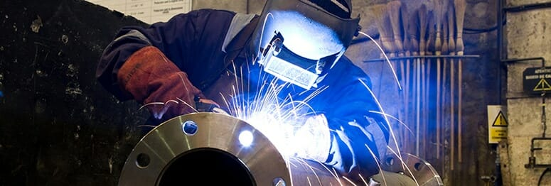 man with gloves and helmet welding, perfect gift