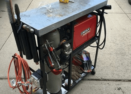 old cart with wires and gas tank