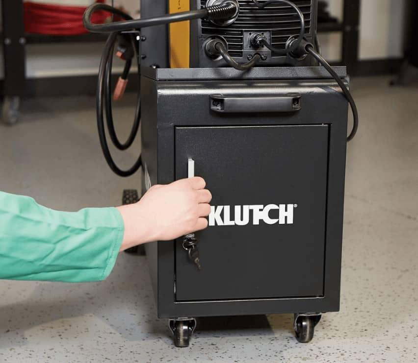 black klutch with arm opening door